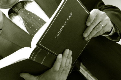 man-holding-criminal-book